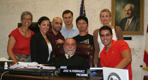 Students in a group photo with Judge Jose M. Rodriguez